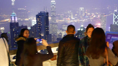 Two women photographed against night aerial city,... Stock Video Footage