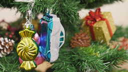 Decoration of Christmas tree bear and car toy. Pan Stock Video Footage