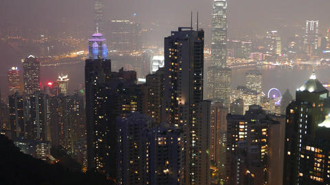 Night cityscape from above, panoramic view from Victoria Peak, dark skyscrapers Footage