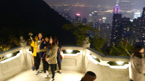 Group of teenager tourist make selfie against wonderful night city panorama Footage