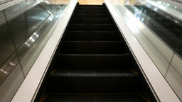 Travelling up by steel and glass escalator Stock Video Footage