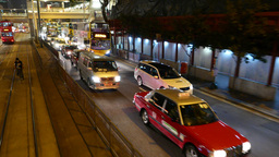 Tram overtake slow traffic on the night street of HongKong Footage