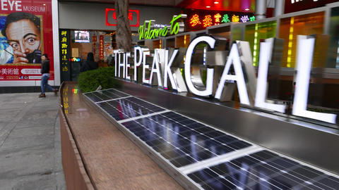 "Pan along ""The Peak Galleria"" sign on peak square, wide... Stock Video Footage"