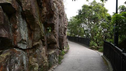 Narrow foot-way around mountain. POV walk forward, nature Stock Video Footage