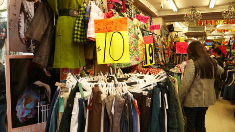 Cheap garments shop in the market, chinatown, price tag... Stock Video Footage