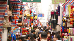 Extremely crowded market street, looking over people heads Stock Video Footage