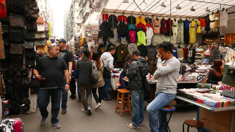Walking slowly on the street market, garments section Footage