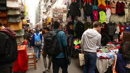 Walking slowly on the street market, garments section Stock Video Footage