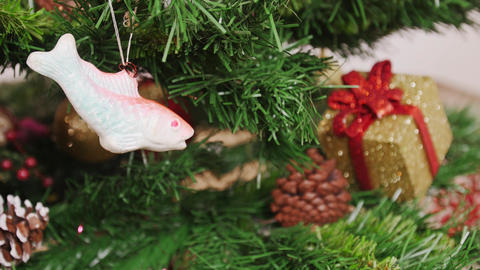 Decoration of Christmas tree fish toy. Pan Footage