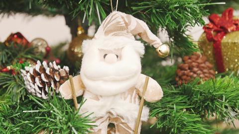 Decoration of Christmas tree Santa Claus on skis Footage