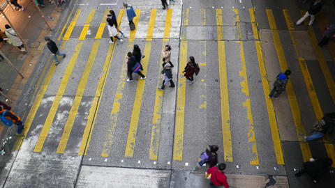 Sparce people flow on crosswalk, view from the top Stock Video Footage