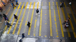 Sparce people flow on crosswalk, view from the top Footage