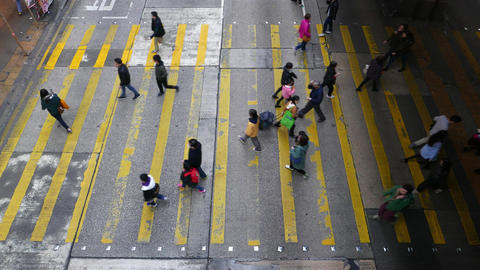 General view of wide crosswalk from the top point. People walk Footage