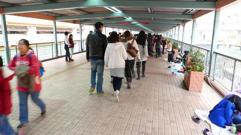 Pedestrian bridge, people walking, hurry contrast with... Stock Video Footage