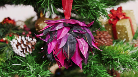 Decoration of Christmas tree purple flower toy Stock Video Footage