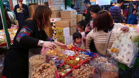 Chinese kids at candy stall in open market Stock Video Footage