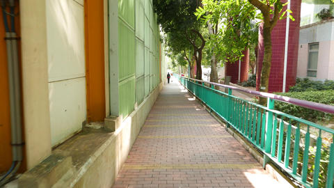 Pedestrian walkway divided with very high wall from traffic area, POV walk Live Action