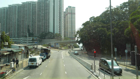 Quiet city district, just few car traffic, sunglare on cars Stock Video Footage
