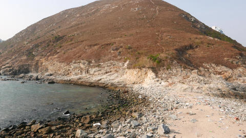 Pan shot of Ap Lei Chau island from small washed sand stripe Stock Video Footage