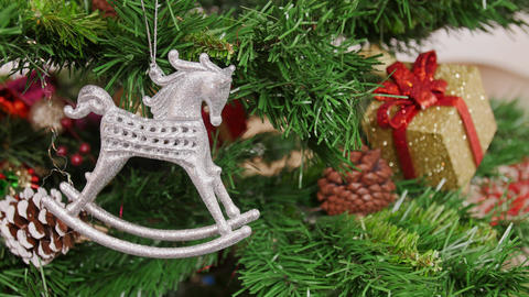Decoration of Christmas tree horse toy. Pan Stock Video Footage