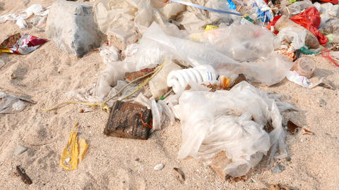 Rubbish lie on sand, camera move close to used mercury... Stock Video Footage