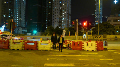 Two young pedestrians crossing the street on red light Stock Video Footage