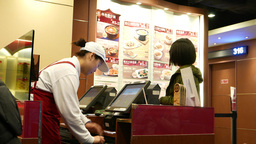 Client make order to cashier, cashier receive money Footage