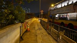 Walking on the empty footpath in the night. Way leads to bridge Footage