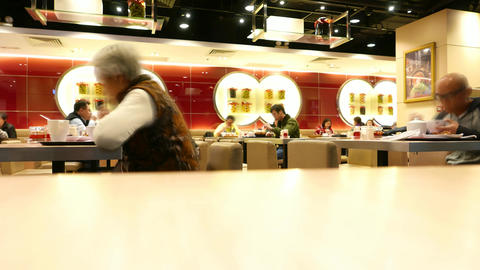 Unidentified asian people eat chinese food in bistro, time lapse shot Footage