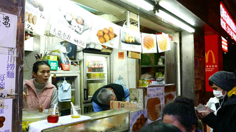 Waffles Kiosk On Night Street, POV Walk Around, Several Citizens Wait In Queue stock footage