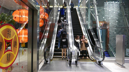 Rising up on the escalator next to girl with beautiful legs Stock Video Footage
