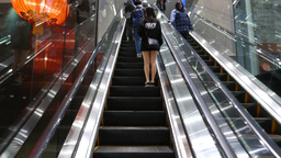 Rising up on the escalator next to girl with beautiful legs Footage