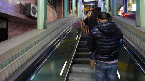 Cross the street between two escalators, night time Stock Video Footage