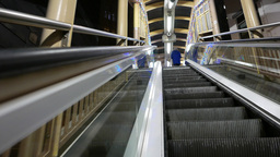 Side view from the moving escalator, upper perspective Footage