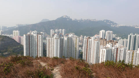 Densely built-up area at bottom of hill, walk and view... Stock Video Footage