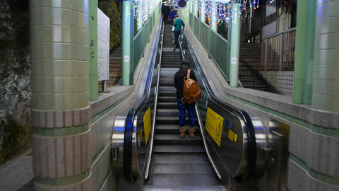 Entering and exiting escalator section, people on the way Stock Video Footage