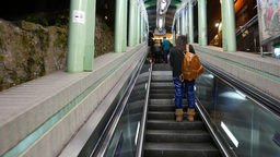 Entering and exiting escalator section, people on the way Footage