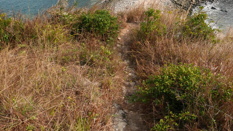 Descent down a steep slope, meeting man climbing up Stock Video Footage