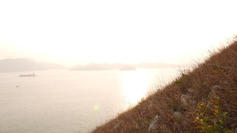 Overbright Sea Horizon Line And Dry Grass Hillside On Foreground stock footage