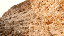 Crumbling chalk stone hillside, rusty in evening light Stock Video Footage