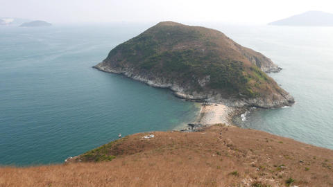 Aquamarine sea waters, small Ap Lei Pai island, misty... Stock Video Footage