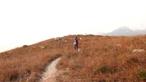 Long follow shot hiker come along winding trodden path at... Stock Video Footage