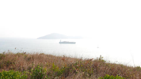Ship on harbour waters, misty and bright overexposed water Footage