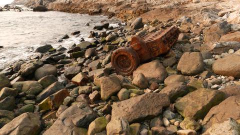Vessel engine rusty carcass on rocky shore, POV camera... Stock Video Footage