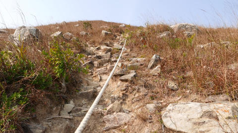 Climb up rocky dangerous path on mountain Stock Video Footage