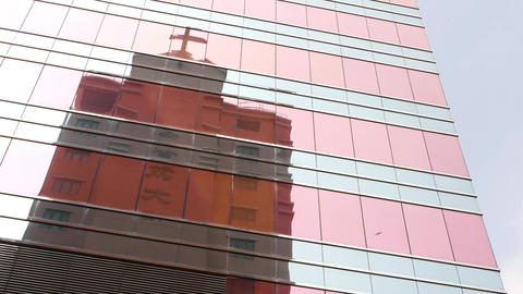 Church building reflection in flat glass walled tower,... Stock Video Footage