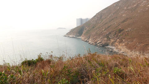 Climb down winding trail, mountain islands panorama Stock Video Footage