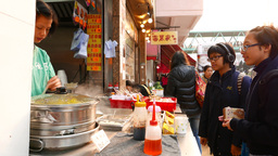 Chinese fastfood: woman cooking food for scholars Stock Video Footage