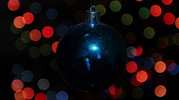 Christmas ball at background of blurred lights Stock Video Footage