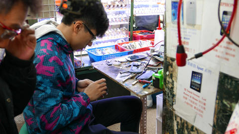 Young master in repair on knee market service, work with... Stock Video Footage